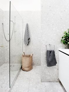 Modern Renovation Of A Melbourne Townhouse In the bathroom, the existing shower cubicle was converted into a laundry area and a new walk-in shower installed. In keeping with the home's sensibilities, terrazzo tiles were laid from floor to ceiling. Grey Bathrooms, White Bathroom, Bathroom Interior, Modern Bathroom, Bathroom Ideas, White Shower, Bathroom Photos, Bath Ideas, Shower Ideas
