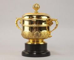 A George V silver gilt trophy cup, engraved