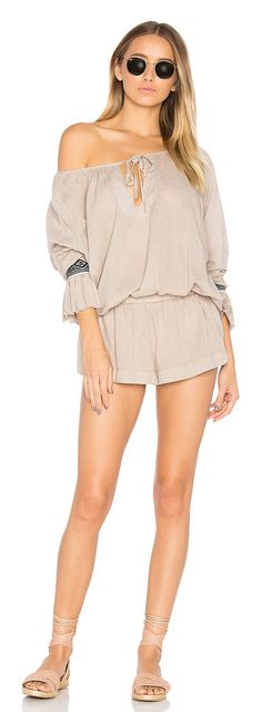 """The Rose Hill Muslin Romper by One Teaspoon. Whoever said """"""""don't slouch,"""""""" hasn't seen this. The Rose Hill Muslim Romper features a loose, relaxed fit and flared..."""