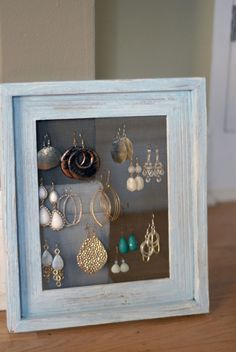 earring holder - It's just an old frame, screen door fabric, a staple gun and some staples.