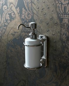 Accessories ensure your bathroom's look & feel are carried through to minute details - Wall-mounted single soap dispenser ceramic from Arcade Bathrooms. http://www.arcadebathrooms.com/Products/ProductDetail?prodId=80085&name=Wall-mounted%20single%20soap%20dispenser%20ceramic