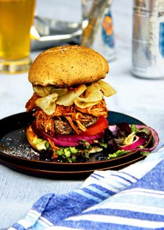 """Texas-sized Angus Steakhouse Burger with Smoked Brisket, Kettle Chips and BBQ Boss Sauce 