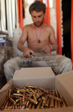 A soldier loads ammunition into a magazine at a forward operating base (FOB) near Garmsir in Helmand, Afghanistan.