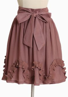 "So cute!    Sweet Swirls Shimmer Skirt In Mauve  44.99 at shopruche.com.     We love this feminine skirt in gray with a delicate overlay and a  hint of shimmer. Finished with a ruffled applique, an optional waist  sash, and a hidden side zipper closure.  100% Polyester, Imported, Waist: 30"", 21"" length from top of waist, *All measurements taken from a size Small"