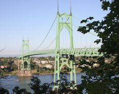 The St. Johns Bridge is a steel suspension bridge that spans the Willamette River in Portland, Oregon. It is the only suspension bridge in the Willamette Valley and one of three public highway suspension bridges in Oregon. Downtown Portland, Portland Oregon, Portland Neighborhoods, Bridge Painting, Oregon Waterfalls, State Of Oregon, Willamette Valley, Suspension Bridge, George Washington Bridge