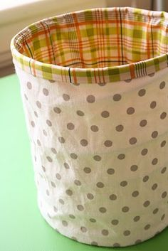 Collapsible fabric buckets.  These would be cute for the playroom with different fabric for each child.