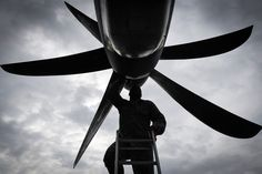 Tech. Sgt. Rainier Howard, 374th Aircraft Maintenance Squadron crew chief, performs preflight inspection of a C-130J Super Hercules at Kadena Air Base, Japan, March 6, 2017. This is the first C-130J to be assigned to Pacific Air Forces. Yokota serves as the primary Western Pacific airlift hub for U.S. Air Force peacetime and contingency operations. Missions include tactical air land, airdrop, aeromedical evacuation, special operations and distinguished visitor airlift. (U.S. Air Force photo…