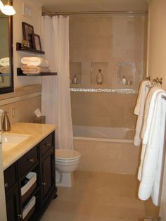 Outdated Condo Bath to Elegant Oasis, Small 70s condo bathroom, is now a luxurious yet functional sanctuary. Featured are Mother-of-Pearl ac...