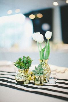 tulips and succulents in gold mercury glass, photo by Jenavieve Belair http://ruffledblog.com/glam-ace-hotel-wedding #centerpieces #reception