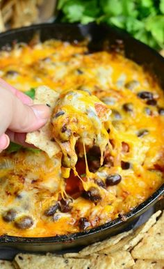 Hot 7-Layer Dip ~ loaded with beef, veggies, and cheese, and served hot from the skillet!| willcookforsmiles.com