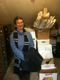 City Archivist Nadia Dixson in her office at the City Hall Annex. Dixson wades through the city's trove of old files to create historical ex...
