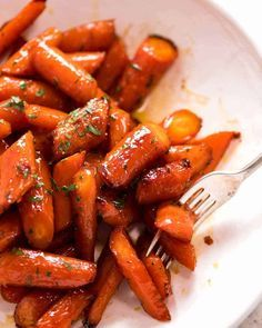 Brown Sugar Glazed Carrots - - Recipe video above. The most amazing quick and easy roasted carrots! Roasting brings out the best in carrots, always. And the caramelised edges are the BEST - it's the only way I make Glazed Carrots! Veggie Side Dishes, Vegetable Sides, Side Dish Recipes, Vegetable Recipes, Food Dishes, Vegetarian Recipes, Cooking Recipes, Healthy Recipes, Veggie Recipes Sides