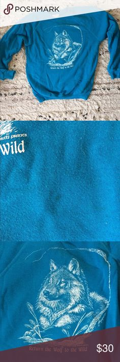 Vintage wolf sweatshirt Return the wolf to the wild! This rad vintage pullover sweatshirt is in great shape! Only one small stain that is hardly noticeable(pictured) the graphics are still vibrant and in tact! The graphic is the same on both front and back.    Size reads M 38-40 but It's more like an extra small Tops Sweatshirts & Hoodies