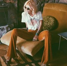 70S Velvet flares with a concert tee and platforms.