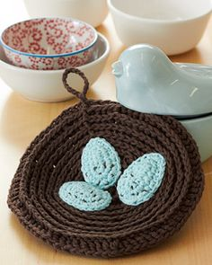 Looking to up your crochet skills? This dishcloth, with its robin's egg appliques, is the perfect way to launch yourself into the Intermediate level! Shown in Lily Sugar'n Cream. #crochet