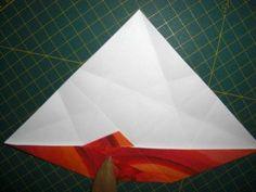 instrucción 5 para hacer una corona navideña de origami
