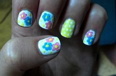 spring nails! blue and pink flowers, yellow, white, dots
