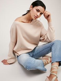 The Check Sweater | Comfortable sweater with a super stretchy fabrication. Structured and slightly off-the-shoulder neckline with drapey sleeves make it a cool, effortless look. Band at the waist.
