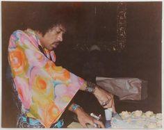 "zoso-scarlett: "" Jimi Hendrix cutting his birthday cake. """