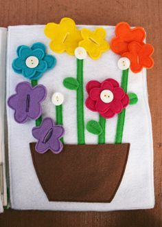 Felt Quiet Book - idea page (love the color matching, but use colored buttons to designate where each colored flower goes)