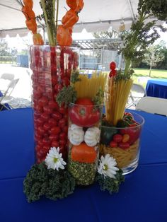 Pasta, veggies, glass jars... makes for a delightful and colorful centerpiece... edible too! Tres Bella Weddings & Events   Affordable and colorful#picnic centerpiece, affordable centerpiece, colorful centerpiece, holiday centerpiece, country wedding, hostess gift