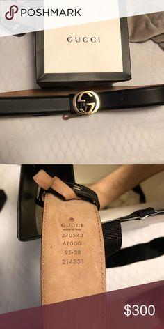 10b434a02b8a Gucci belt Black leather Light fine gold-toned hardware Interlocking G  buckle with stud closure