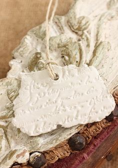 White Clay Tag Torn Page French Script Gift tag Ornament: Hand Stamped Clay Shabby Paris.