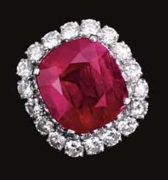 ATTRACTIVE RUBY AND DIAMOND RING, BULGARI.  The cushion-shaped ruby weighing 10.07 carats, set within a double border of brilliant-cut diamonds, mounted in platinum,  signed Bulgari.