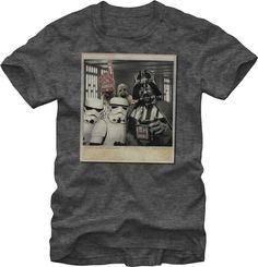 Wait, who is that behind Darth Vader and his Storm Troopers? It's Chewie, everyone's favorite Wookiee.  Showcase Chewbacca's humorous side with this photo bomb Star Wars tee shirt, which depicts a Polaroid-style photograph with Chewie photo bombing the bad guys' picture.