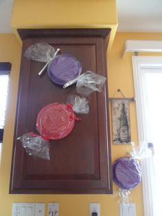 Willie Wonka decor... Frisbee or paper plates in cello wrap.