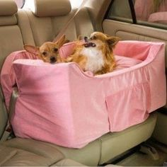 Happy national pet owner's day: Snoozer Pink Luxury Lookout II Double Dog Car Seat. Snoozer Pink Luxury Lookout II Double Dog Car SeatThe Snoozer Pink Luxury Lookout II Double Dog Car Seat will keep your pets safe and secure while riding in the car. Two security straps allow you to secure two small dogs to the vehicle's car seat for maximum safety and peace of mind - a must have for multi-dog households. The dog car seat is also great for use with one medium size dog.