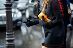 The 50 Most Whimsical Bags of Fashion Month: Anna Dello Russo carries a Charlotte Olympia gummi bear clutch.