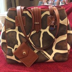 ⚡️REDUCED⚡️Dooney Animal print tote Preowned in great condition! Only used a few times leather handles in great condition  material fabric with leather trims and shiny gold hardware. Some wear on the bottom edges but very minor.comes with leather ID wristlet that is detachable. Additional pictures in my closet....PRICE FIRM Dooney & Bourke Bags Totes