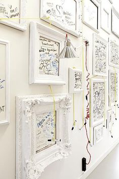 Framed whiteboards...doodle away!  Good for a studio for idea boards.