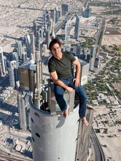 Tom Cruise sitting on the very top of the Burj Khalifa in Dubai during the filming of Mission Impossible 4. And he did his own stunts. Gotta give him credit...he has guts. http://www.youtube.com/watch?v=V_QXKgYqg4c