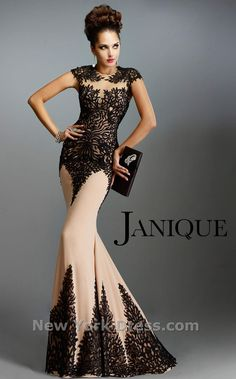 Have a fabulous night wearing this Janique K6472 evening gown. This dress has cap sleeves and contrast abstract lace works throughout. The fitted silhouette leads
