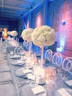 Glamorous hydrangea centerpieces at a Winter Wonderland Wedding by Michael Daigian Design.