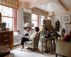 "Gloria Vanderbilt in her bedroom on Beekman Place. The apartment is a laboratory for her, and redecorating it a kind of tonic. ""I had the idea to start putting up mirrors in different places so that it has a sort of 'Alice Through the Looking Glass' feeling to it,"" Ms. Vanderbilt said. ""I started off with a little bit here, a little bit there. Of course that led to a little bit more mirror. When you wake up, you go to the other dimension. It feels wonderful."" The silvered round table was…"