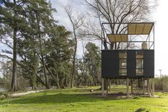 This towering tiny house overlooks a peaceful riverside retreat near Buenos Aires, Argentina. The Delta Cabin by AToT is raised above the ground on a Native Advertising, Plantation Homes, Shipping Container Homes, Large Homes, Small Space Living, Prefab, Interior Architecture, Modern Design, House Design