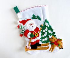 Bucilla felt Christmas stocking titled Skiing Santa. Finished and ready to personalize and ship. More details below. Welcome to HometownUSA We think nothing is more beautiful for those stocking stuffer gifts and goodies than a Bucilla stocking. We love making them and hanging them up