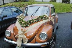 We provide wedding car decoration included using terry bear, mickey mouse, flowe. Wedding Getaway Car, Wedding Day, Wedding Blog, Floral Wedding Decorations, Wedding Flowers, Bridal Car, Flower Car, Rose Garland, Deco Floral