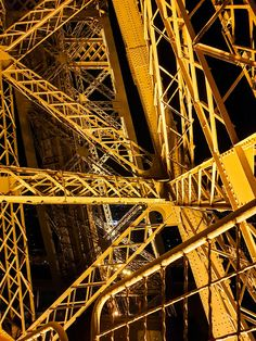 Inside the Eiffel Tower at night. Building Architecture, Architecture Design, Eiffel Tower At Night, Gustave Eiffel, Tour Eiffel, High Quality Images, Stools, Notre Dame, Counter