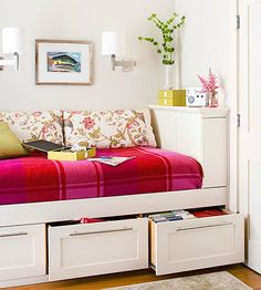 Double Up ~~ Tap into wasted space for storage in a small space. Drawers built in beneath this daybed corral files, extra linens & more. Are built-ins out of your budget? Invest in a bed skirt and shallow plastic bins that can slide under your bed. The skirt conceals the affordable, but not always pretty, bins and the space beneath your bed now houses more than just dust bunnies.