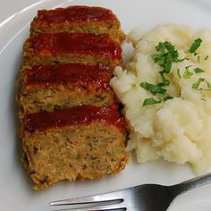 Home-style Vegan Meatloaf Recipe Main Dishes with white onion, celery ribs, carrots, garbanzo, olive oil, garlic cloves, soy sauce, lemon zest, dried basil, dried oregano, dried sage, panko breadcrumbs, vital wheat gluten, water, glaze, ketchup