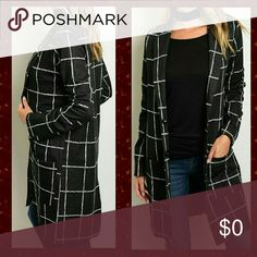 """Long Black Windowpane Jacket White windowpane print. Two snap button front. Two front pockets. Light jacket. Long. Back slit. Polyester blend.  Small: Length: 35.5"""" Pit to pit: 18""""  Medium:  Length: 36.5"""" Pit to pit: 19.5""""  Large: Length: 37"""" Pit to pit: 20.5"""" Boutique Latiya Jackets & Coats"""
