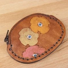 Handmade Leather Coin Purse with poppies on it - a gorgeous way to carry your spare change!