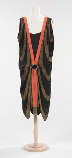 """Evening Dress: ca. 1925, French, silk, metal. """"This dress is a perfect representation of the flapper era of the 1920s. Breaking free from the confining dresses of days past, the chest was flattened, the waist was dropped and the hemline was raised..."""""""