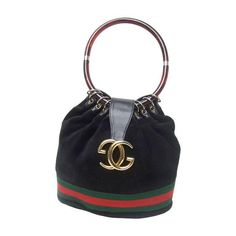 Luxurious Black Suede Gucci Bag With Lucite Handle. 1970's. | From a collection of rare vintage top handle bags at https://www.1stdibs.com/fashion/handbags-purses-bags/top-handle-bags/