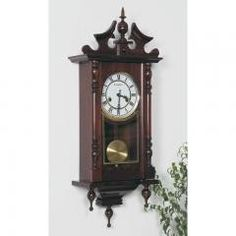 BROOKWOOD WALL CLOCK Features beautifully crafted wood with a glass front that reveals the swinging pendulum inside. A beautiful time piece for your home on Lish, $224.95 USD