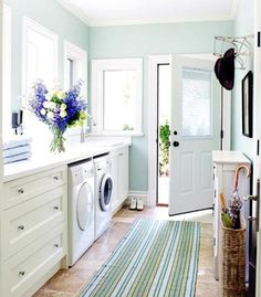 the turquoise walls are perfection. very Martha Stewart. love this laundry room.